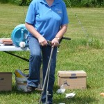 Anne Verhallen, OMAFRA, demonstrates some of the common tools used to take soil samples, as part of a workshop on soil management and identification at the 2012 spring informational and Wind Dance Stable and Farms, Picton, hosted by Larry Roache.